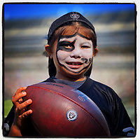 OAKLAND, CA - NOVEMBER 3: iPhone Instagram of a young girl Raider fan on the field before before the game between the Detroit Lions and Oakland Raiders at the Oakland Coliseum on November 3, 2019 in Oakland, California. (Photo by Brad Mangin)