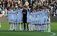Pictured: Swansea players observe a minute's silence  before kick off in memory of Wales football manager Gary Speed who has died. Saturday 27 November 2011<br /> Re: Premier League football Swansea City FC v Aston Villa at the Liberty Stadium, south Wales.