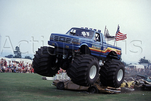 9 June 1993: Bigfoot shows off its car crushing ability during a Monster Trucking event at Crystal Palace, London. Photo: Neale Haynes/Action Plus...930609.motor motorsports motorsport sport big wheels giant truck crush squash