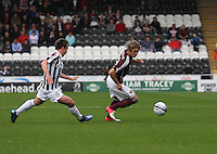 Arvydas Novikovas beats Paul McGowan in the St Mirren v Heart of Midlothian Clydesdale Bank Scottish Premier League match played at St Mirren Park, Paisley on 15.9.12.