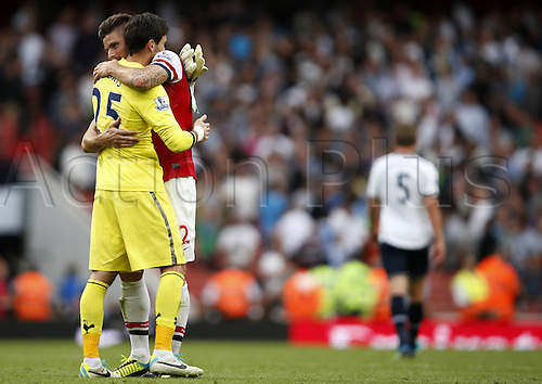 02.09.2013 London, England. Olivier Giroud and Hugo Lloris after The Barclays Premier League Match between Arsenal and Tottenham Hotspur at the Emirates Stadium.