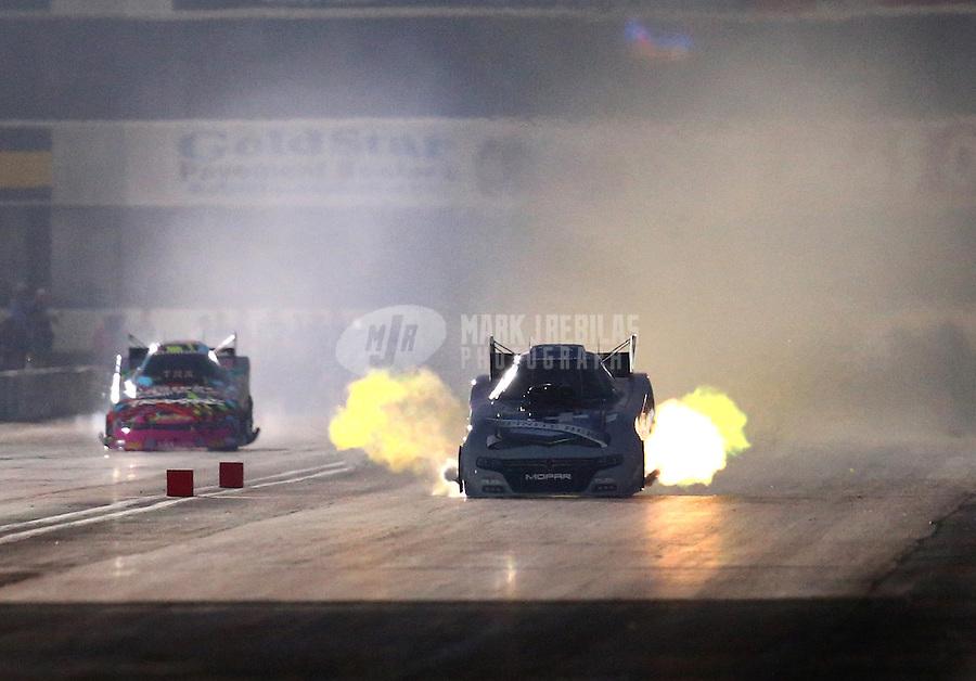 Feb 13, 2016; Pomona, CA, USA; NHRA funny car driver Jack Beckman during qualifying for the Winternationals at Auto Club Raceway at Pomona. Mandatory Credit: Mark J. Rebilas-USA TODAY Sports