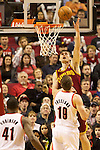 01/15/13--Cleveland Cavaliers center Tyler Zeller (40) tips in the ball against Portland Trail Blazers center Joel Freeland (19) in the first half at Moda Center.<br />