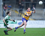 Kevin Keane of  Clare  in action against Brian Foley of  Limerick during their Munster Minor football quarter final at  Cusack Park. Photograph by John Kelly.