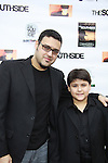 "Gregori J. Martin (executive producer, worte and directed film) poses with his son Dante (both in the film) at The private Industry Screening of ""The Southside"", A Lany Film Tribute to Robert Areizaga, Jr. on February 27, 2012 at Tribeca Cinemas, New York City, New York.  (Photo by Sue Coflin/Max Photos)"