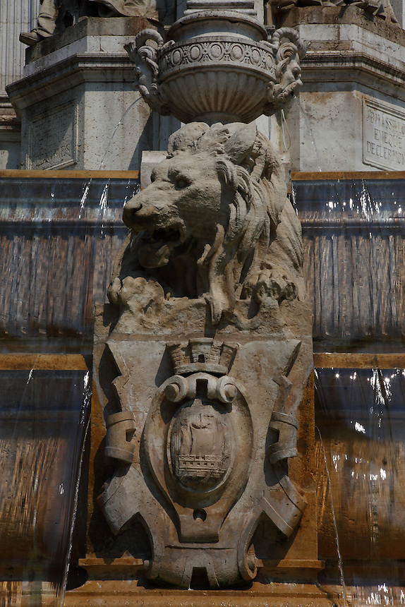 A particular of the fountain in place Saint Sulpice in Paris, with water, in a sunny spring day: A majestic aggressive sculpted lion which holds the coat of arm of the town, which represents a vessel. Digitally Improved Photo.