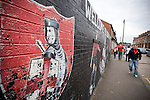 Crusaders 1 Fulham 3, 16/07/2011. Seaview Park, Europa League 2nd qualifying round first leg. Fans walking past a mural at Seaview Park, Belfast before Northern Irish club Crusaders take on Fulham in a UEFA Europa League 2nd qualifying round, first leg match. The visitors from England won by 3 goals to 1 before a crowd of 3011. Photo by Colin McPherson.