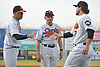 Long Island Ducks manager Kevin Baez, left, and owner / coach Bud Harrelson shake hands with pitcher Dennis O'Grady #17 during pregame introductions that preceded the team's season home opener against the Southern Maryland Blue Crabs at Bethpage Ballpark in Central Islip, NY on Friday, May 4, 2018.