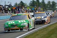 6-8 August, 2010, Watkins Glen, New York USA.Kyle Busch (#18) leads Jeff Burton (#31)..©2010 F.Peirce Williams, USA.