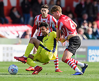 Cheltenham Town's Conor Thomas is fouled by Lincoln City's Mark O'Hara<br /> <br /> Photographer Chris Vaughan/CameraSport<br /> <br /> The EFL Sky Bet League Two - Lincoln City v Cheltenham Town - Saturday 13th April 2019 - Sincil Bank - Lincoln<br /> <br /> World Copyright © 2019 CameraSport. All rights reserved. 43 Linden Ave. Countesthorpe. Leicester. England. LE8 5PG - Tel: +44 (0) 116 277 4147 - admin@camerasport.com - www.camerasport.com