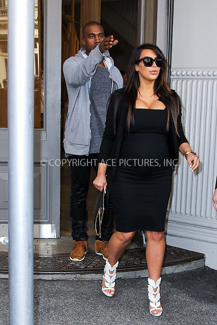 WWW.ACEPIXS.COM....April 22 2013, New York City....Kim Kardashian and Kanye West leave the Isabel Marant store in Soho on April 22 2013 in New York City....By Line: John Peters/ACE Pictures......ACE Pictures, Inc...tel: 646 769 0430..Email: info@acepixs.com..www.acepixs.com