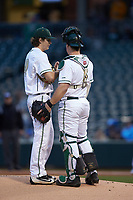 Charlotte 49ers starting pitcher Chase Gooding (40) talks with catcher Harris Yett (8) against the North Carolina Tar Heels at BB&T BallPark on March 27, 2018 in Charlotte, North Carolina. The Tar Heels defeated the 49ers 14-2. (Brian Westerholt/Four Seam Images)