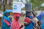 Women carry water in the Doro Refugee Camp in Maban County, South Sudan. Doro is one of four camps in Maban which together shelter more than 130,000 refugees from the Blue Nile region of Sudan. Jesuit Refugee Service, with support from Misean Cara, provides educational and psycho-social services to both refugees and the host community.