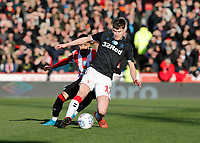 8th February 2020; Griffin Park, London, England; English Championship Football, Brentford FC versus Middlesbrough; Paddy McNair of Middlesbrough shields the ball from Said Benrahma of Brentford  - Strictly Editorial Use Only. No use with unauthorized audio, video, data, fixture lists, club/league logos or 'live' services. Online in-match use limited to 120 images, no video emulation. No use in betting, games or single club/league/player publications