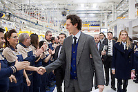 Torino: il Presidente FIAT John Elkann saluta gli operai dello stabilimento Maserati Gianni Agnelli Plant durante l'avvio della produzione della nuova Maserati Quattroporte...Turin:  President of FIAT John Elkann shakes hands with workers in the new Maserati plant dedicated to Gianni Agnelli. .It will produce the new model of Maserati Quattroporte.