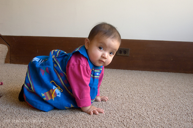 Berkeley CA Eight-month-old Guatemalan girl starting to crawl  MR