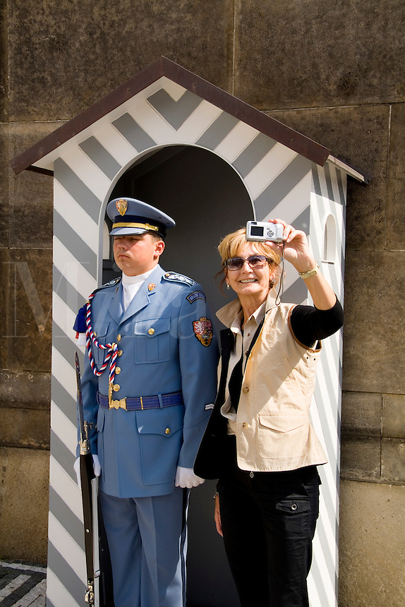 Tourist taking picture with Archbishop Palace guard in stand, Prague,   Czech Republic
