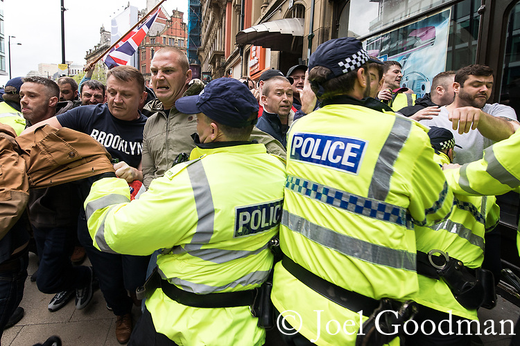 "© Joel Goodman - 07973 332324 . 11/06/2017 . Manchester , UK .  Demonstration against Islamic hate , organised by former EDL leader Tommy Robinson's "" UK Against Hate "" and opposed by a counter demonstration of anti-fascist groups . UK Against Hate say their silent march from Piccadilly Train Station to a rally in Piccadilly Gardens in central Manchester is in response to a terrorist attack at an Ariana Grande concert in Manchester , and is on the anniversary of the gun massacre at the Pulse nightclub in Orlando . Photo credit : Joel Goodman"