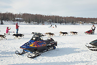 Jason Mackey passes spectators on Long Lake during the restart of the Iditarod sled dog race in Willow, Alaska Sunday, March 3, 2013.