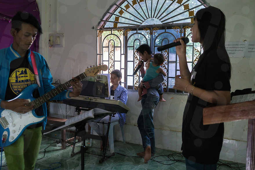 August 27, 2016 - Pailin (Cambodia). Youth  practice songs ahead of the Sunday's service at Pailin's B. P. Presbyterian Church. Several former Khmer Rouge cadres attend this small church weekly. © Thomas Cristofoletti / Ruom