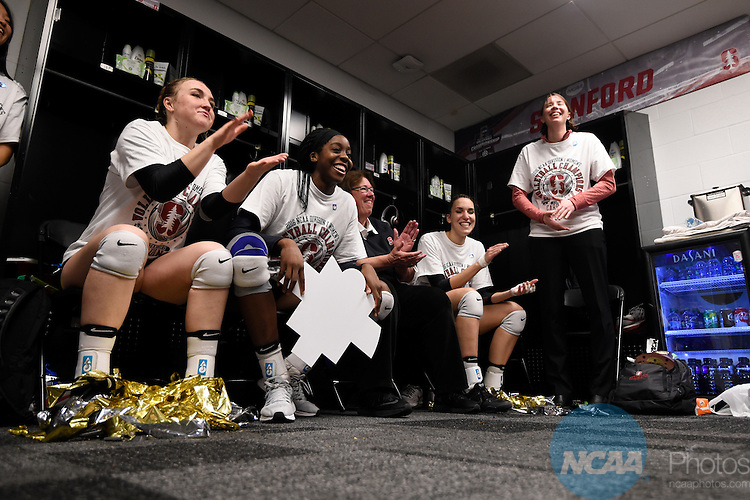 COLUMBUS, OH - DECEMBER 17:  Inky Ajanaku (12) of Stanford University talks with her team after defeating the University of Texas during the Division I Women's Volleyball Championship held at Nationwide Arena on December 17, 2016 in Columbus, Ohio.  Stanford defeated Texas 3-1 to win the national title. (Photo by Jamie Schwaberow/NCAA Photos via Getty Images)