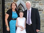 Sadhbh O'Brien who received first holy communion in St Michael's church Clogherhead pictured with parents James and Fiona. Photo:Colin Bell/pressphotos.ie