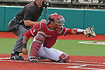 P.J. Jones frames a strike during the Pac-12 Conference tilt between the Washington State Cougars and the Arizona State Sun Devils at Bailey-Brayton Field in Pullman, Washington, on May 24, 2014.  The Cougars defeated the 21st ranked Sun Devils, 10-7.