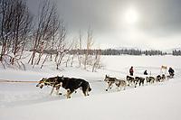 Aaron Burmeisters team leaves Finger Lake Chkpt past Iditarod Trail Sign Finger Lake Alaska 2006 Iditarod