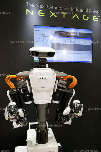 "The Next-generation industrial robot ""NEXTAGE"" of Kawada Industries is a production and manufacturing robot that works alongside human workers performs at the International Robot Exhibition 2013 in Tokyo, Japan, November 6, 2013. The IREX is the largest robot trade fair in the world and shows new robots and high technology equipments at theTokyo International Big Sight. The exhibitions runs from November 6 to 9. (Photo by Rodrigo Reyes Marin/AFLO)"