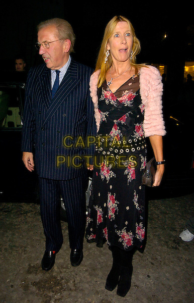 SIR DAVID FROST & LADY CARINA FROST.The Pepe Jeans New Ambassador party, 17 Berkeley Street, London, UK..October 4th, 2006.Ref: CAN.full length blue pinstripe suit black floral print dress pink fur jacket funny face.www.capitalpictures.com.sales@capitalpictures.com.©Can Nguyen/Capital Pictures