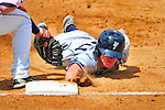 18 July 2010: Staten Island Yankees infielder Jeffrey Farnham dives safely back to first during action against the Vermont Lake Monsters at Centennial Field in Burlington, Vermont. The Lake Monsters fell to the Yankees 9-5 in NY Penn League action. Mandatory Credit: Ed Wolfstein Photo