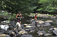 A family explores the Eno River State Park, near Durham, NC, August 2009.  (Photo by Brian  Cleary/www.bcpix.com)