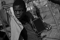 Haiti in 2010, shortly after the earthquake.<br /> <br /> Fifteen percent of the purchase price of this print will be donated to Zanmi Lakay, a non-profit dedicated to improving the lives of Haiti's street children.