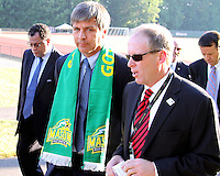 Harold Mayne-Nicholls talks to Kevin Payne of DC United during the visit of the FIFA World Cup 2018-2022 inspection delegation to George Mason University soccer practice facility.
