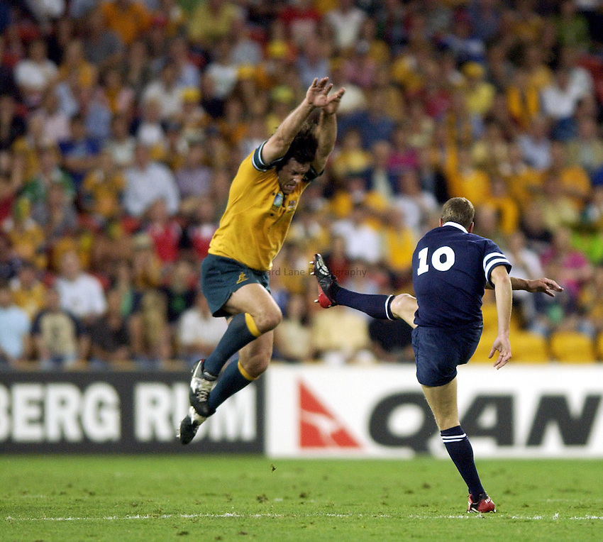 Photo: Richard Lane..Australia v Scotland.  Quarter-Final 2, at the Suncorp Stadium, Brisbane. RWC 2003. 08/11/2003..Brendan Cannon attempts to charge down Chris Patterson's drop goal.