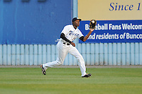 Asheville Tourists center fielder Delta Cleary Jr. #24 makes a catch during a game between the Delmarva Shorebirds and the Asheville Tourists at McCormick Field, Asheville, North Carolina April 6, 2012. The Shorebirds won the game 7-2  (Tony Farlow/Four Seam Images)..