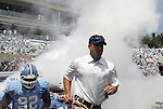 01 September 2012: UNC head coach Larry Fedora leads his players onto the field. The University of North Carolina Tar Heels played the Elon University Phoenix at Kenan Memorial Stadium in Chapel Hill, North Carolina in a 2012 NCAA Division I Football game.