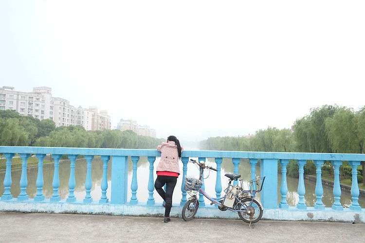 Bicyclist, Shanghai canal, People Republic of China 2013 (Gerard Burkhart Photo)