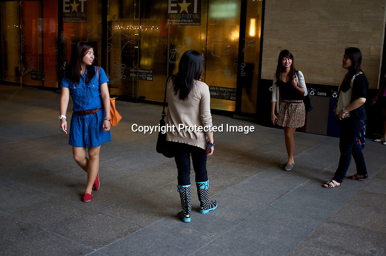 Young filipino shoppers seen walking around the Greenbelt mall in the city of Makati in the Philippines. Photo: Sanjit Das