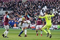 Winston Reid of West Ham United stops Alvaro Morata of Chelsea during the Premier League match between West Ham United and Chelsea at the Olympic Park, London, England on 9 December 2017. Photo by Andy Rowland.