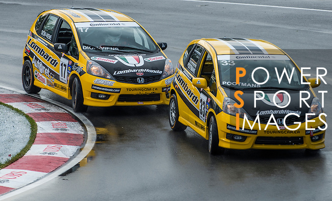 Lambardi Honda Racing drivers PSimon Dion-Viens and Greg Pootmans  speed their Honda Fit car during the CTCC official practice race ahead the F1 Grand Prix du Canada at the Circuit Gilles-Villeneuve on June 08, 2012 in Montreal, Canada. Photo by Victor Fraile / The Power of Sport Images