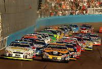 Nov 13, 2005; Phoenix, Ariz, USA;  Nascar Nextel Cup drivers Greg Biffle and Matt Kenseth lead the field to the green during a restart at the Checker Auto Parts 500 at Phoenix International Raceway. Mandatory Credit: Photo By Mark J. Rebilas