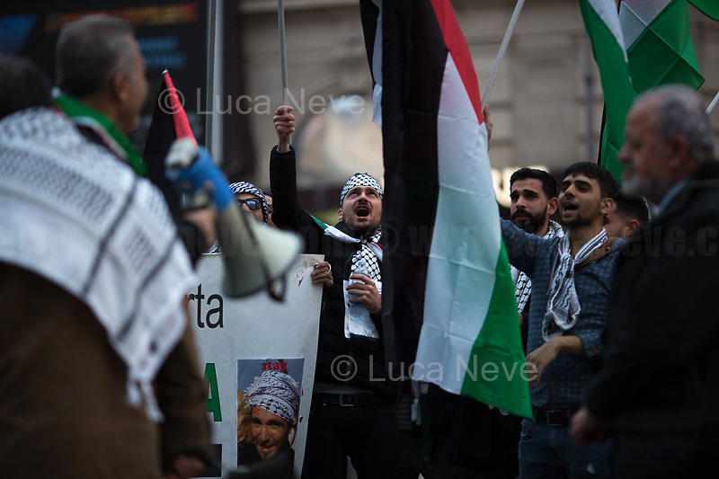 "Rome, 31/01/2020. Today, Pro-Palestinian activists and members of the public gathered in Piazza Barberini to protest (1.) against the ""Peace To Prosperity"" plan (AKA the ""Deal of the Century"", 2.) made by the President of the United States, Donald Trump, to allegedly solve the long-standing conflict between Palestine and Israel. From the organisers Facebook event page: «The Palestinian community in Rome and Lazio invites all those who believe in the values of freedom, justice and self-determination of peoples to held a sit-in Piazza Barberini in Rome in solidarity with the Palestinian people and to ask to reject the shameful plan announced by Trump. The sit-in was organized by the Palestinian Community in Rome and Lazio, Assopace Palestina [3.] and Rete Romana di Solidarietà con il Popolo Palestinese [4.] […]». During the sit-in a small delegation of protesters were allowed to demonstrate outside the US Embassy in Rome, near Piazza Barberini.<br /> <br /> Footnotes & Links:<br /> 1. http://bit.do/frfng<br /> 2. ""Peace To Prosperity Plan"" (Full text. Source, Whitehouse.gov ENG) http://bit.do/frfo3<br /> 3. http://www.assopacepalestina.org/<br /> 4. http://bit.do/frfpo"