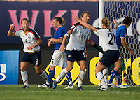 USWNT forward (20) Abby Wambach celebrates her goal with defender (26) Rachel Buehler as teammate (8) Lauren Cheney moves in during the last group stage game at the Peace Queen Cup.  The USWNT defeated Italy, 2-0, at the Suwon Sports Center in Suwon, South Korea.