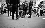 4/17/2015  Yunghi Kim/ Contact Press Images Sunset Park Brooklyn (Brooklyn Chinatown) NY.  A  disorderly man is detained as NYPD waits for an ambulance.