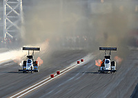 Oct 26, 2018; Las Vegas, NV, USA; NHRA top fuel driver Leah Pritchett (left) alongside Antron Brown during qualifying for the Toyota Nationals at The Strip at Las Vegas Motor Speedway. Mandatory Credit: Mark J. Rebilas-USA TODAY Sports