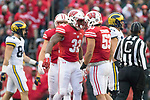 Wisconsin Badgers teammates T.J. Edwards (53) and Leon Jacobs (32) celebrate during an NCAA College Big Ten Conference football game against the Michigan Wolverines Saturday, November 18, 2017, in Madison, Wis. The Badgers won 24-10. (Photo by David Stluka)