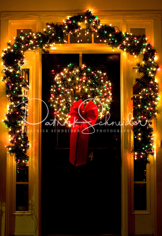 Christmas lights glow on a front door in the town of McAdenville, NC. The town of McAdenville has been celebrating Christmas by decorating the homes in town with red, green and white lights and has come to be known as Christmas Town USA.  The town of McAdenville has been celebrating Christmas by decorating the homes in town with red, green and white lights and has come to be known as Christmas Town USA.