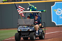 "Columbia Fireflies mascot ""Mason"" points at fans as he rides around the warning track in a golf cart between innings of the game against the Rome Braves on Monday, July 3, 2017, at Spirit Communications Park in Columbia, South Carolina. Columbia won, 1-0. (Tom Priddy/Four Seam Images)"