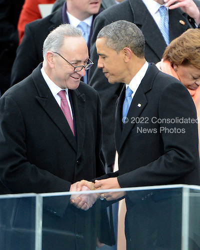 United States President Barack Obama, right, shakes hands with U.S. Senator Chuck Schumer (Democrat of New York) after taking the oath of office during the public swearing-in ceremony at the U.S. Capitol in Washington, D.C. on Monday, January 21, 2013..Credit: Ron Sachs / CNP.(RESTRICTION: NO New York or New Jersey Newspapers or newspapers within a 75 mile radius of New York City)